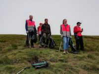 The volunteer team take in the views